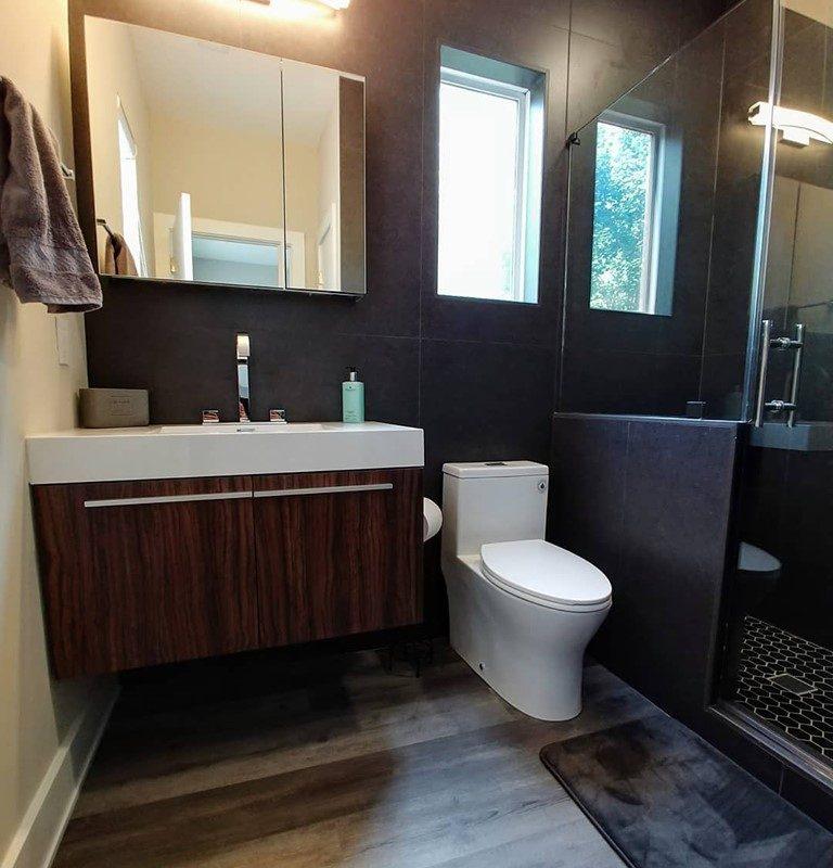 """LVP flooring and 24x48"""" Porcelain tile walls"""