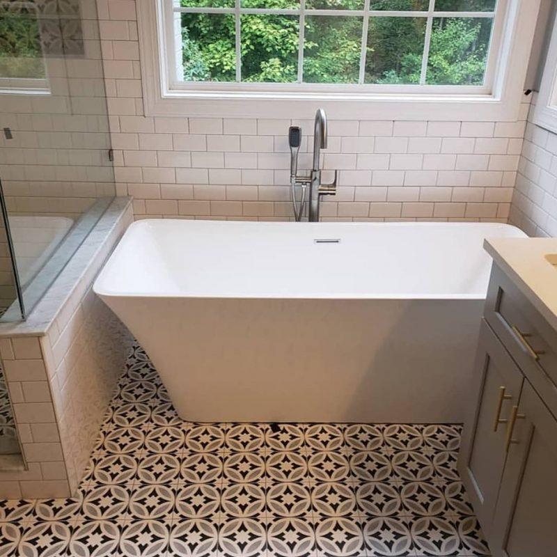 """Deco porcelain tile floor, 3x6"""" subway tile walls"""