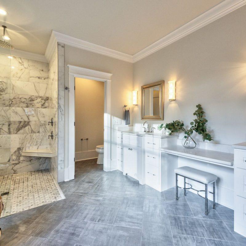 Large-Walk-In-Marble-Shower-And-Herringbone-Floor