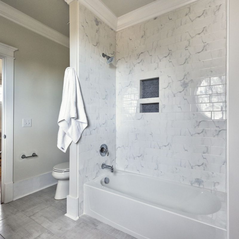 Marble Look Subway Tile With Chevron Accent Niche