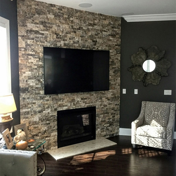 Silver Travertine Stacked Stone fireplace