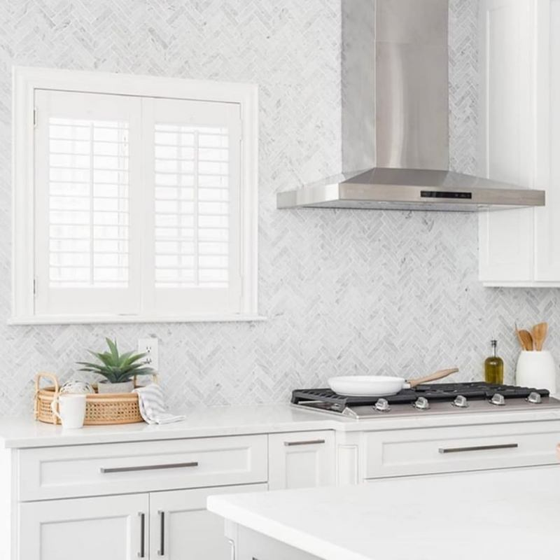 1x4-Carrara-Marble-Herringbone-Backsplash