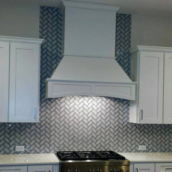 Beveled Glass herringbone backsplash